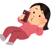 寝転がりながらスマホを使う人(女性).png